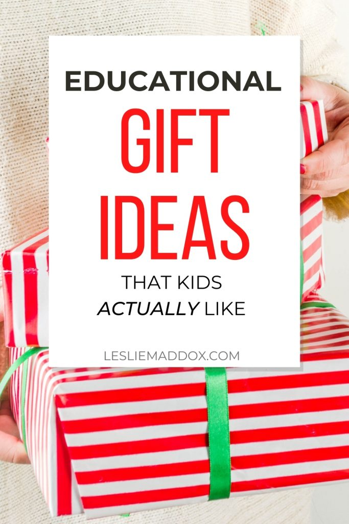 Woman holding wrapped Christmas gifts with text Educational Gift Ideas That Kids Actually Like